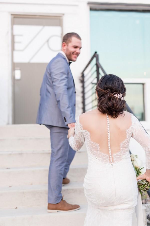 Groom leading bride up steps of East Crossing