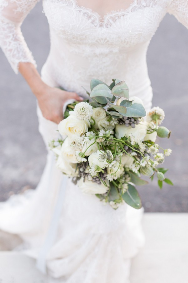 Bride carrying white and green wedding bouquet