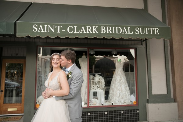Bride and groom in front of Saint-Clark Bridal Suite