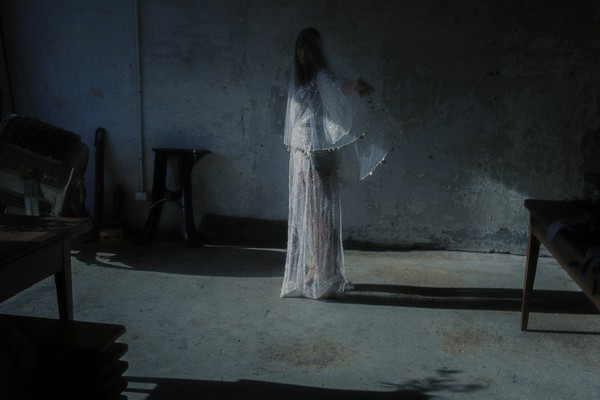 Bride holding arms out in warehouse