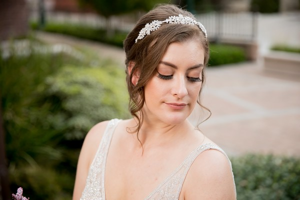 Bride with updo wearing hairpiece
