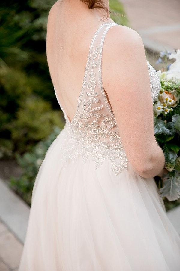 Detail on back of bride's wedding dress