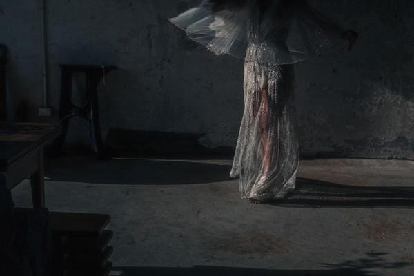 Bride walking in warehouse