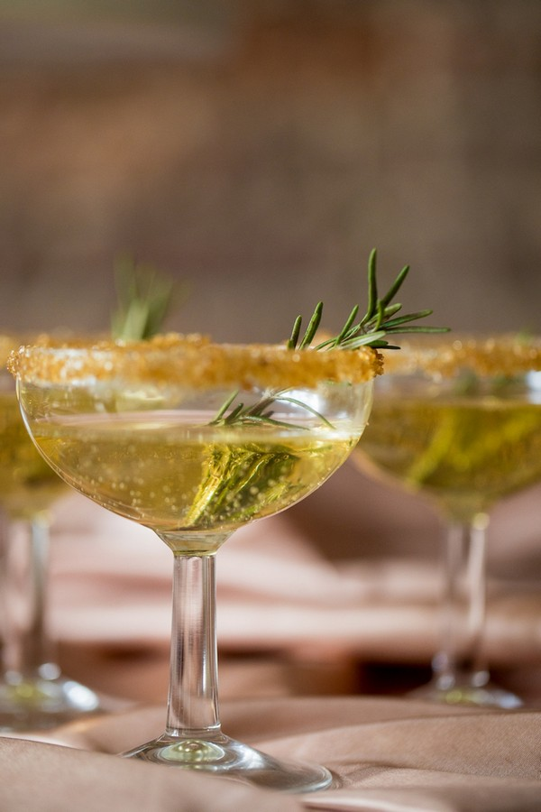 Copper coloured drink with rosemary