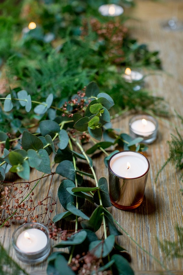 Foliage and copper votives on wedding table