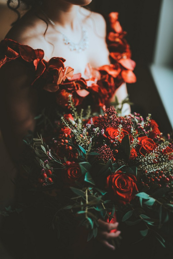 Bride holding red bridal bouquet