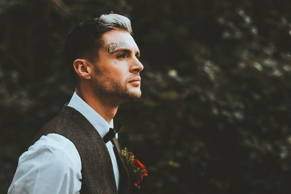 Groom with tattoo on face