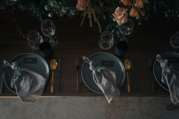 Wedding place settings with grey and gold styling