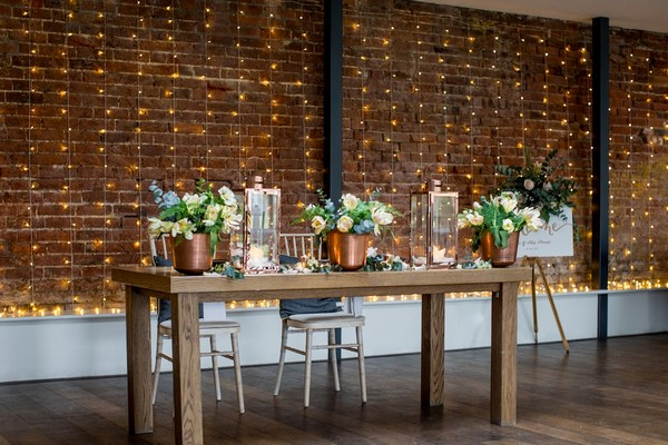 Table with foliage and copper wedding styling