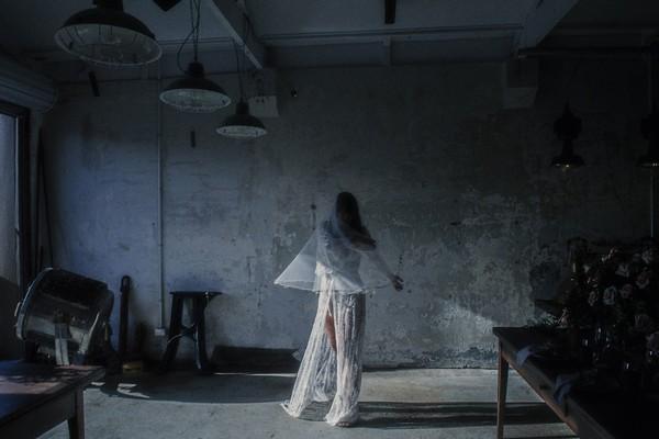 Bride twirling in dark warehouse