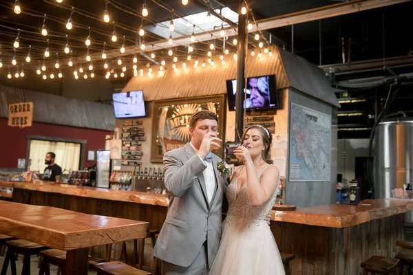 Bride and groom drinking beer in Mt. Lowe Brewery