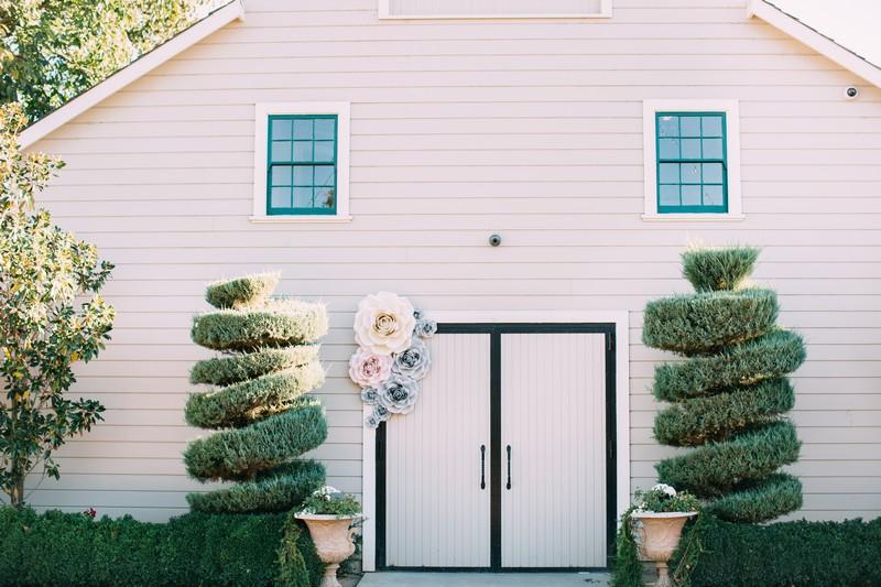 Large paper flowers on door at Scribner Bend Vineyards