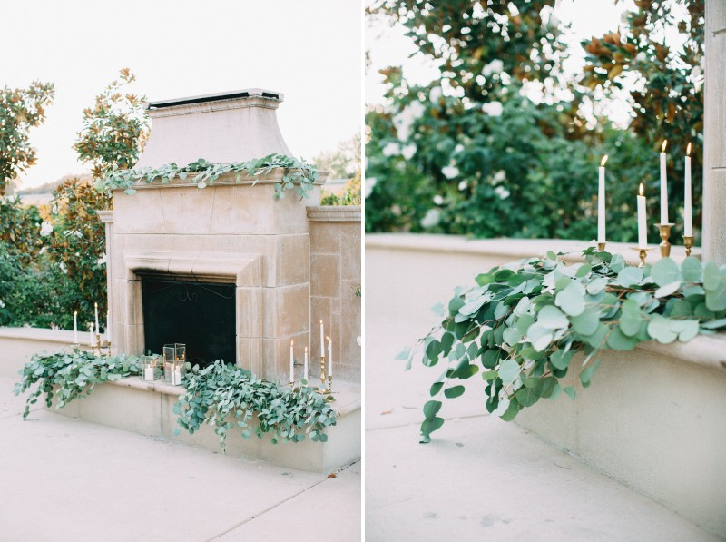 Outdoor fireplace styled with eucalyptus leaves