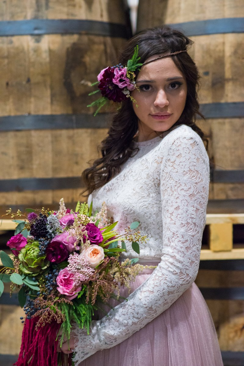 Bride with flowers in her hair holding bouquet