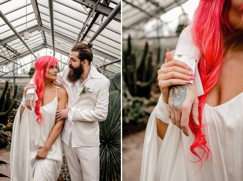 Groom with tattoo on hand with arm around bride