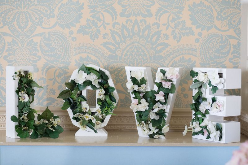 LOVE letters with greenery inside