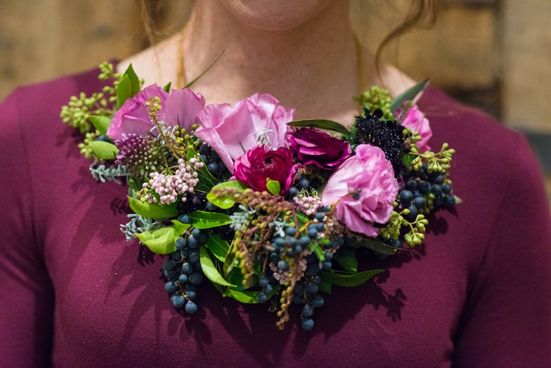 Flowers around bridesmaid's neck