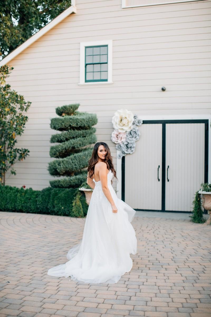 Bride in grounds of Scribner Bend Vineyards