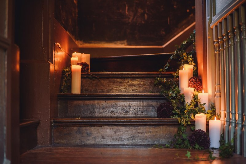 Candles and ivy on stairs
