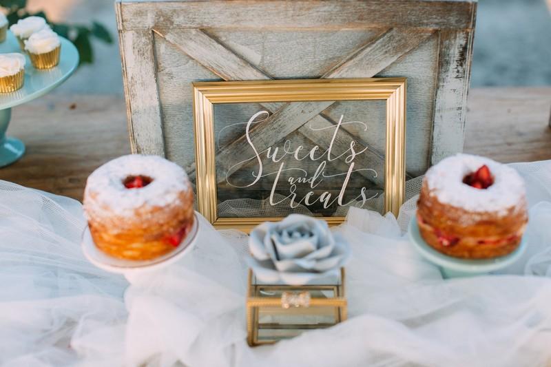 Sweet treats sign on wedding dessert table