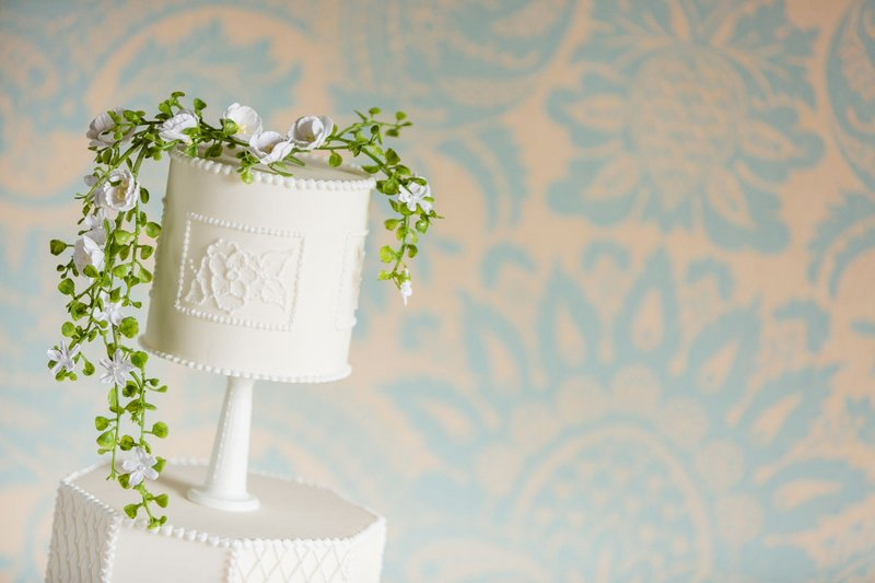 Wedding cake topped white petalled flowers