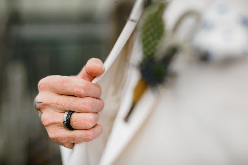 Wedding ring on groom's finger