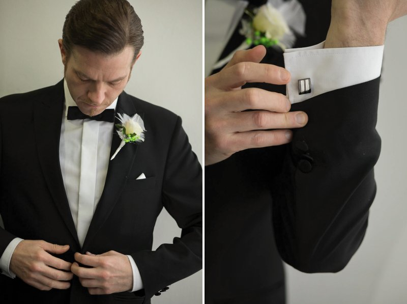 Groom putting on suit jacket