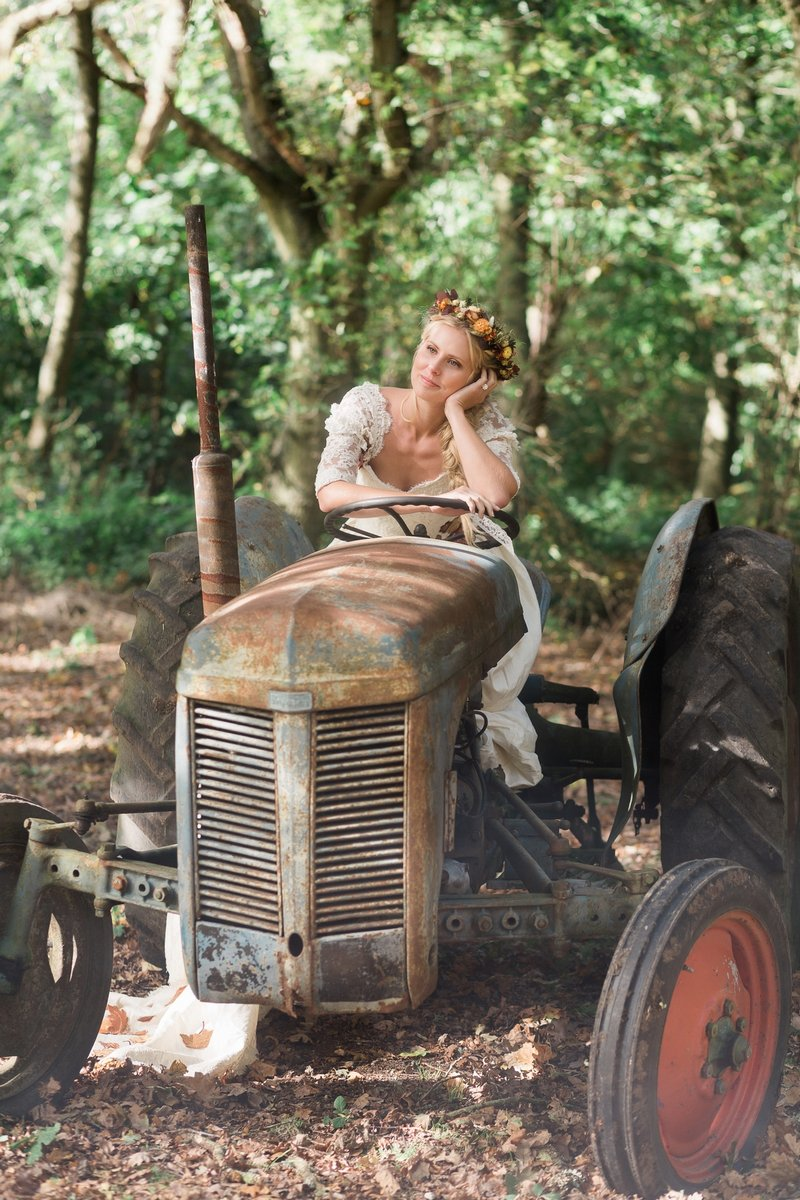 Bride sitting on old tractor