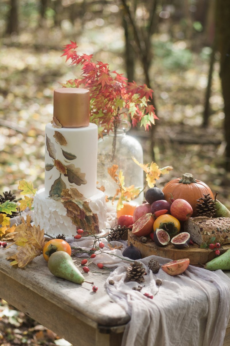 Autumn wedding cake and fruit and vegetables on table