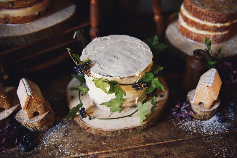 White wedding cake with ivy