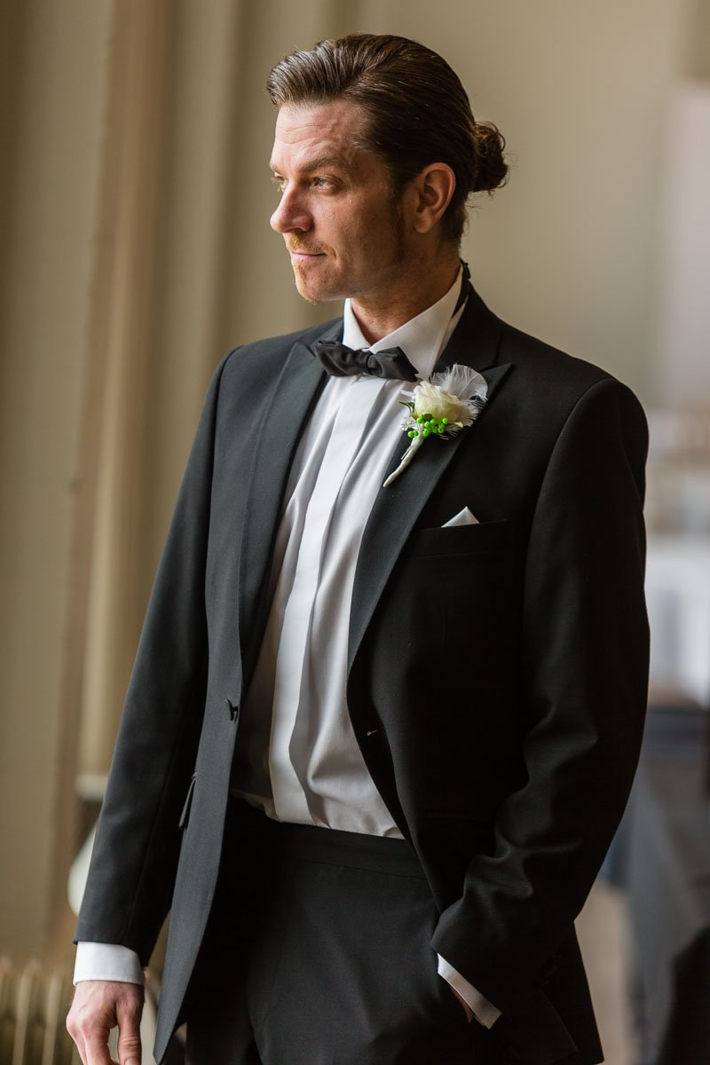Groom in black suit and bow tie