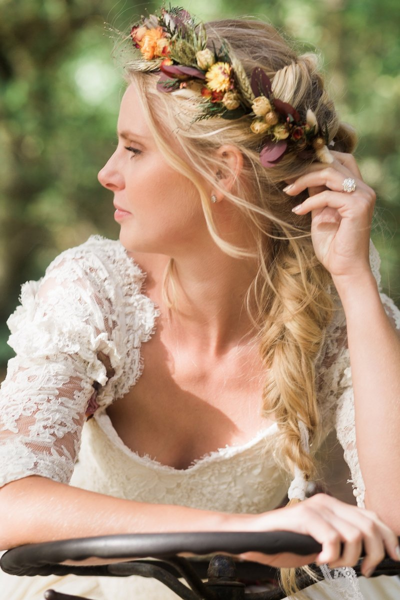 Bride with plait hairstyle wearing autumn flower crown