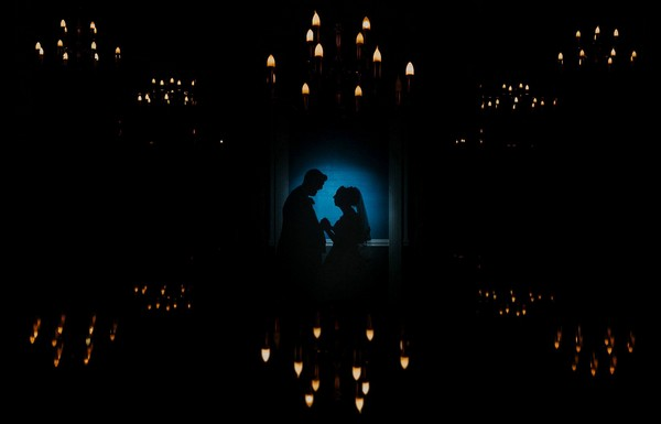 Silhouette of bride and groom surrounded by candle shaped lights - Picture by Craig Roberts Photography