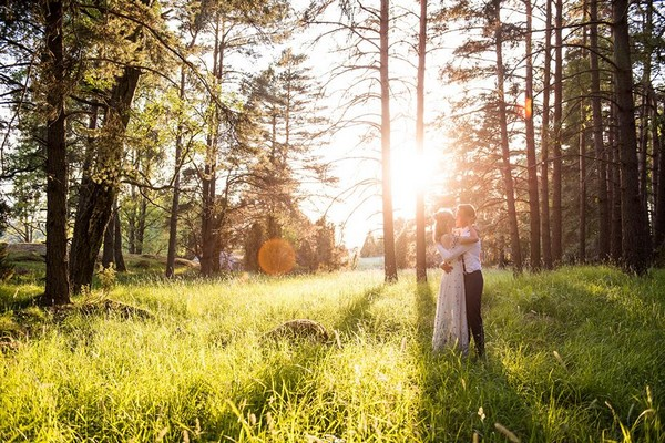 Bride and groom in woodland with sun shining through the trees - Picture by Jessica Grace Photography
