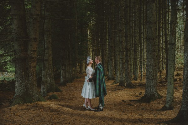 Bride facing Scottish groom surrounded by trees - Picture by The Drawing Room