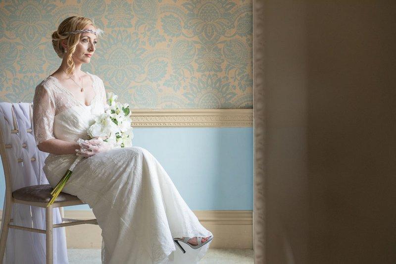 Vintage bride sitting in chair