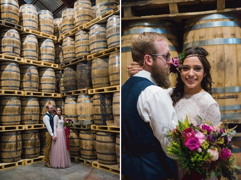 Bride and groom in front of barrels at Breckenridge Distillery