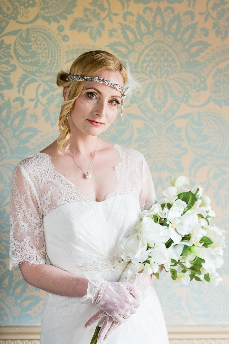 Vintage bride with headband holding white bouquet