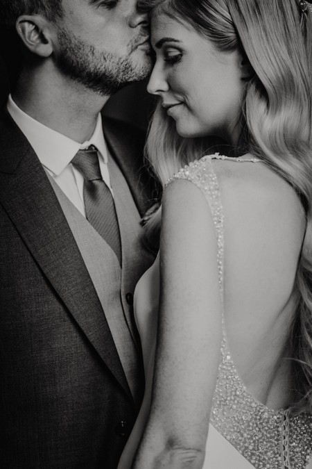 Groom kissing bride on forehead - Picture by Sarah Maria Photography
