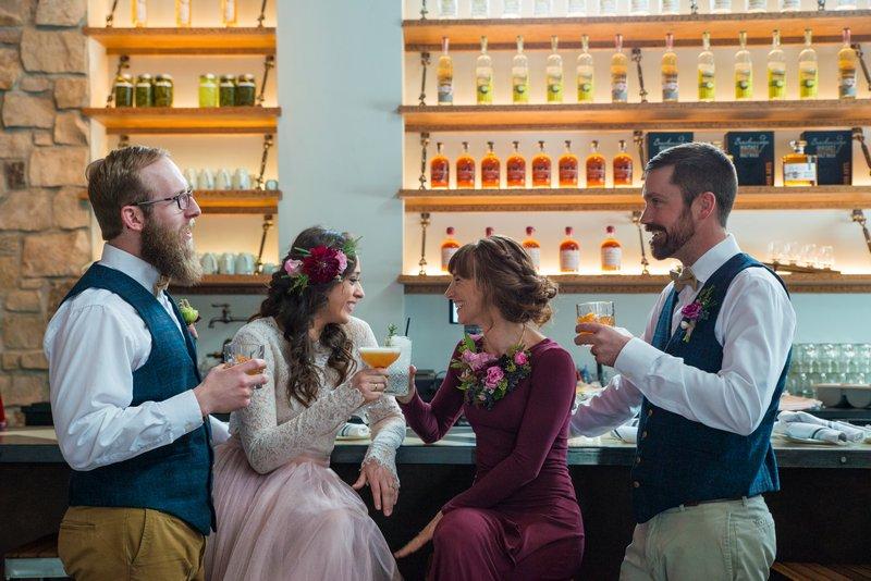 Bridal party having drinks at bar of Breckenridge Distillery