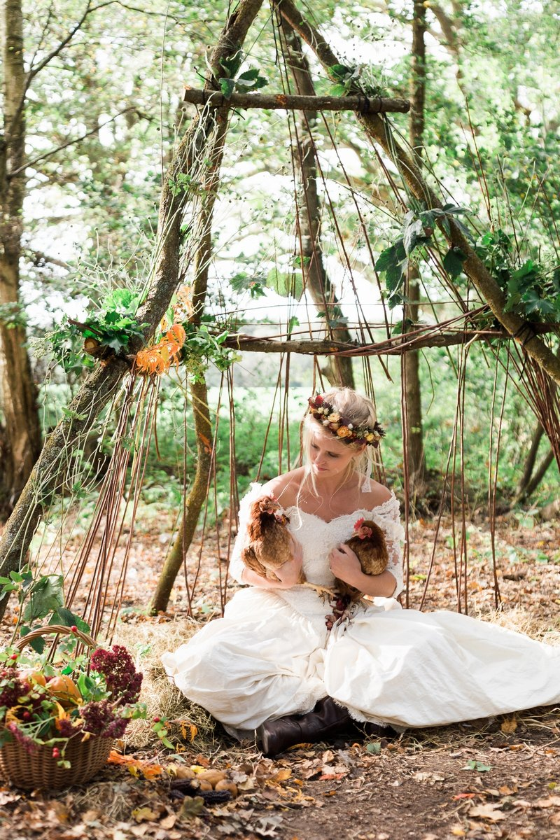 Bride sitting holding chickens
