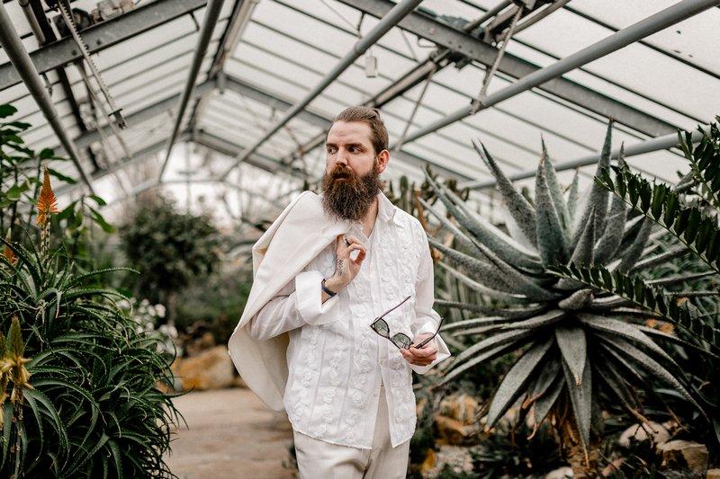 Groom wearing white suit