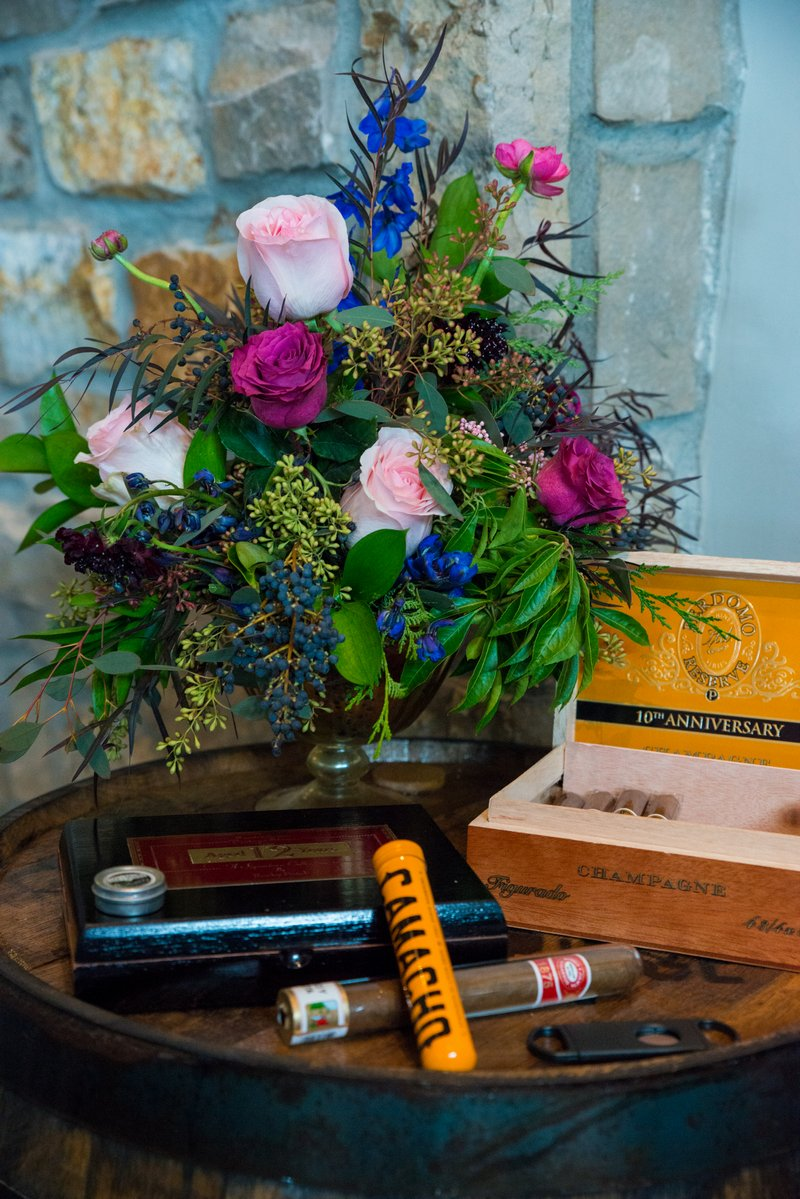 Small tables with cigars and flowers