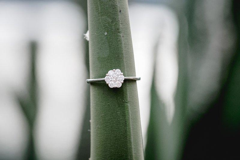 Wedding ring on tropical leaf
