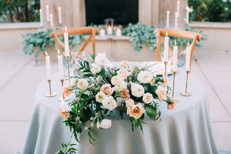 Floral wedding table display with white and light pink flowers