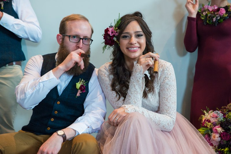 Bride and groom with cigars