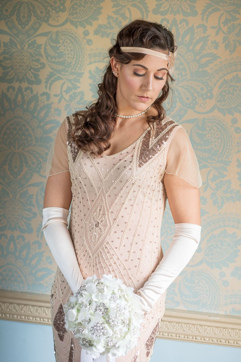 Bridesmaid wearing vintage style headband and long gloves