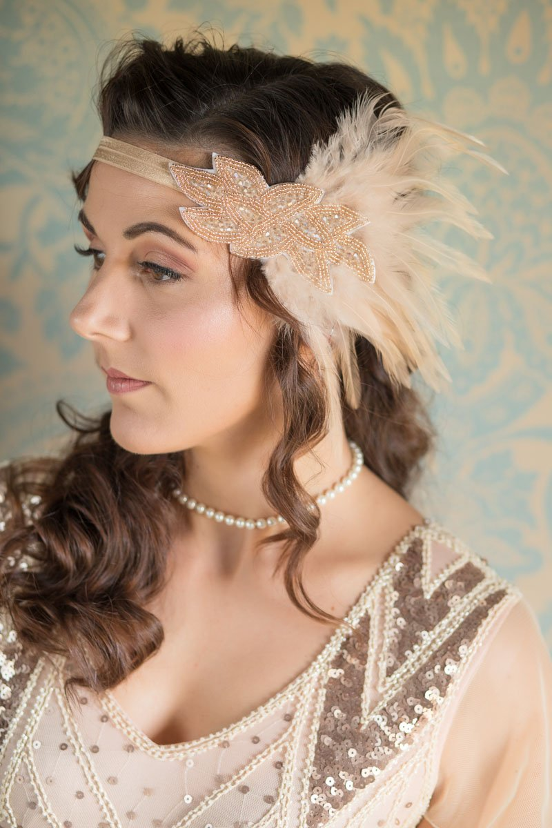 Bridesmaid wearing vintage style headband with feathers