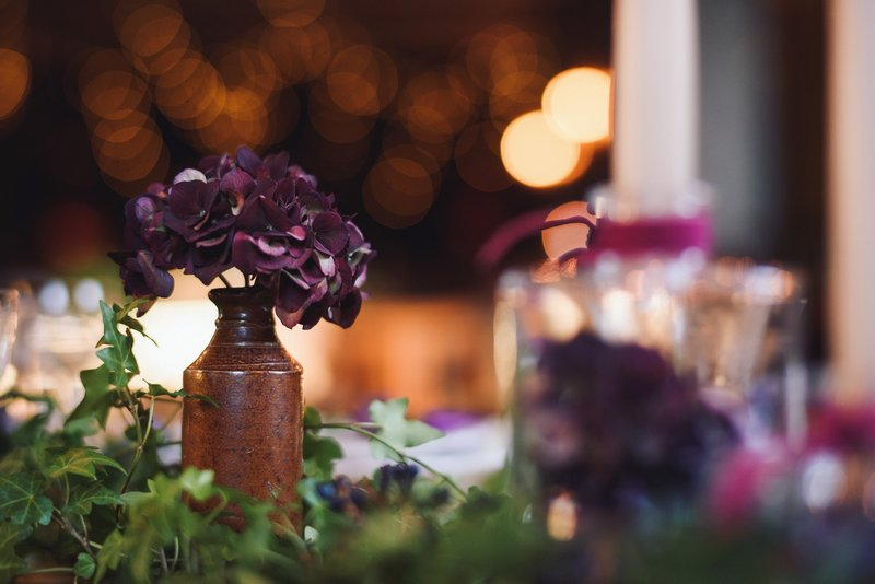 Pot of purple hydrangea on wedding table