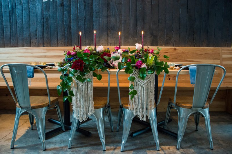 Wedding chairs with macramé hanging from back